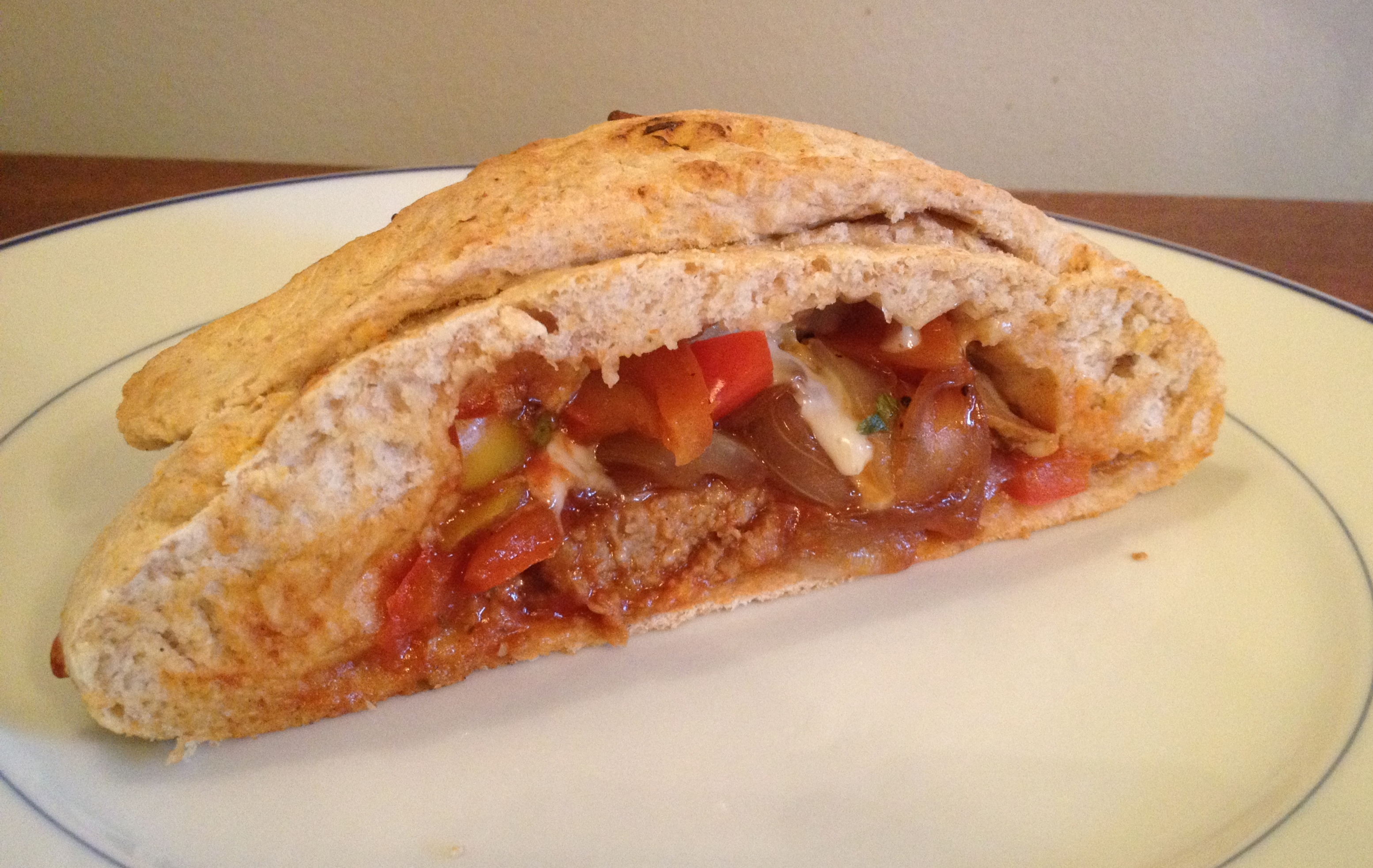 whole-wheat onion, pepper, and sausage calzones.